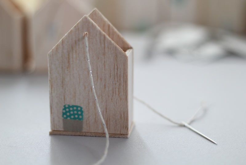 Make houses out of balsa wood (you can cut it with scissors