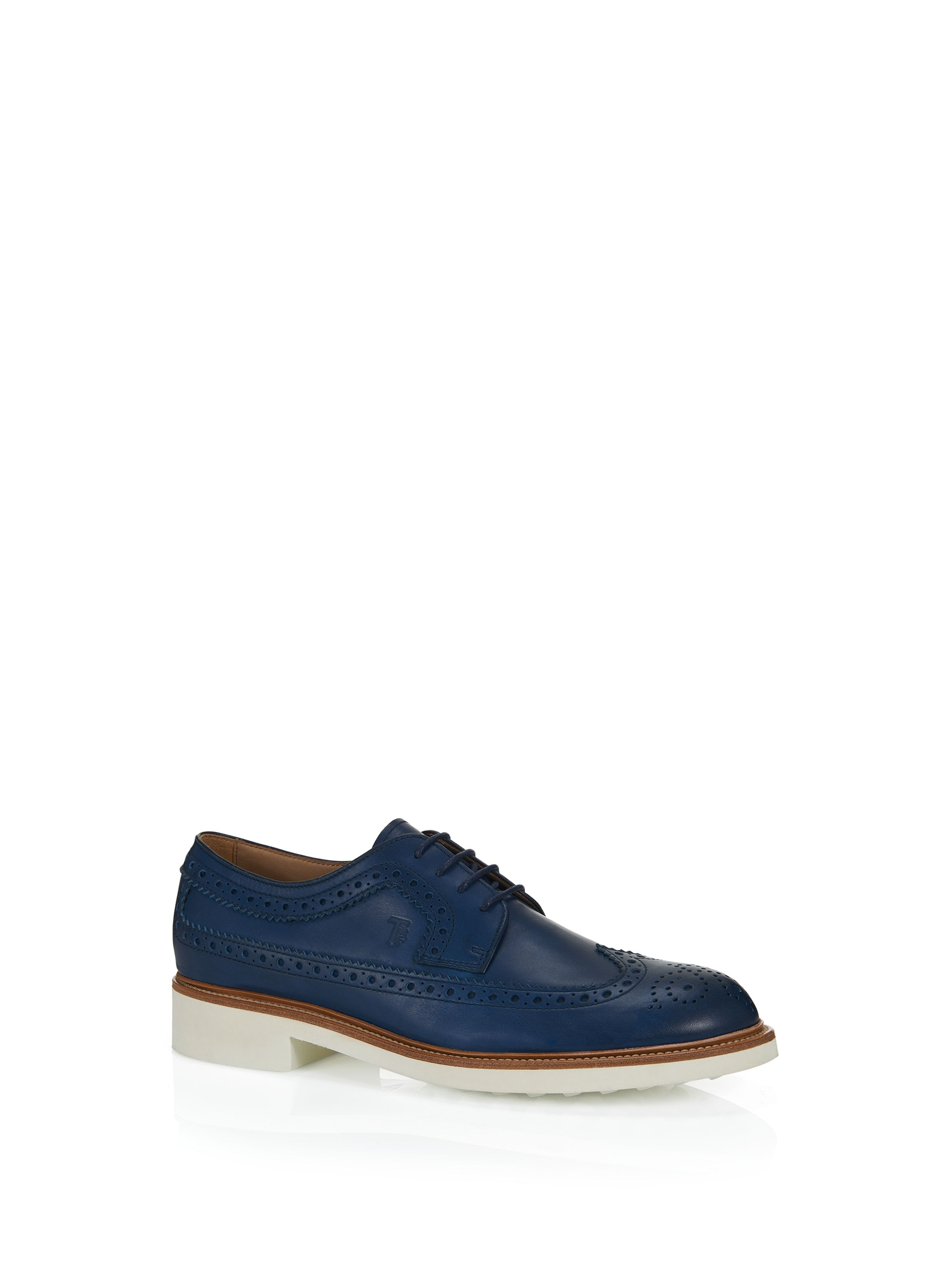 Tod's - Stringata In Pelle - XXM0TC00C10D90U803 - Soft leather lace-up shoes tanned according to artisan methods which preserve its natural patina, featuring traditional English-style wingtip perforations, exposed stitching on the leather welt and ultralight rubber outsole with embossed rubber pebble detailing. - Leather upperExposed stitching on leather weltEnglish-style wingtip perforationsEVA bottom with embossed rubber pebblesTod's stamped monogramHighly selected calf lea
