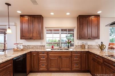 Another view of the spacious kitchen with new walnut ...