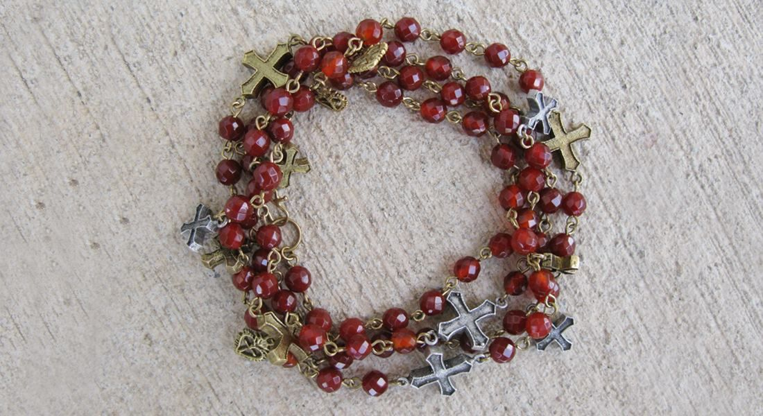 Pax Multicross Carnelian - can be worn as necklace or bracelet Available at Trends and Traditions Boutique