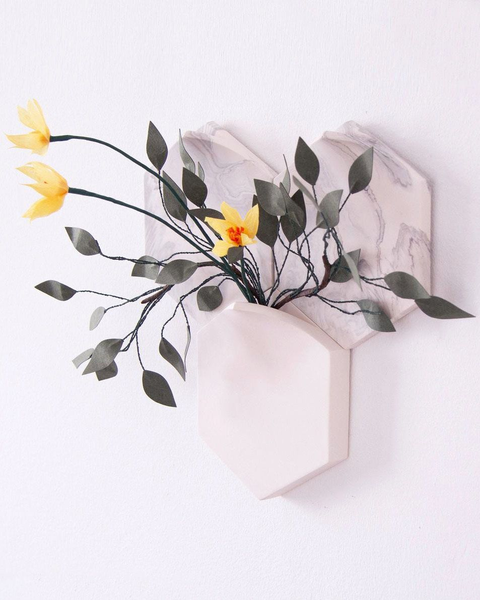 Part artwork, part vase. This sculptural wall art looks stunning with or without the addition of flowers. Add your favorite bouquet to create a piece of living art.