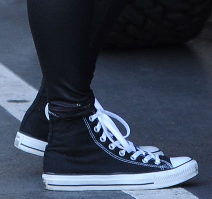 c2c45b47cbe5 Amber Rose Squeezes Ample Assets into Tank Top and Leggings Combo and Chuck  Taylor Converse All Star Shoes