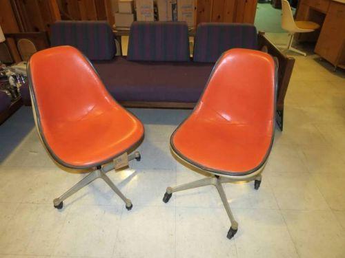Vintage-Herman-Miller-orange-rolling-and-swiveling-desk-chairs