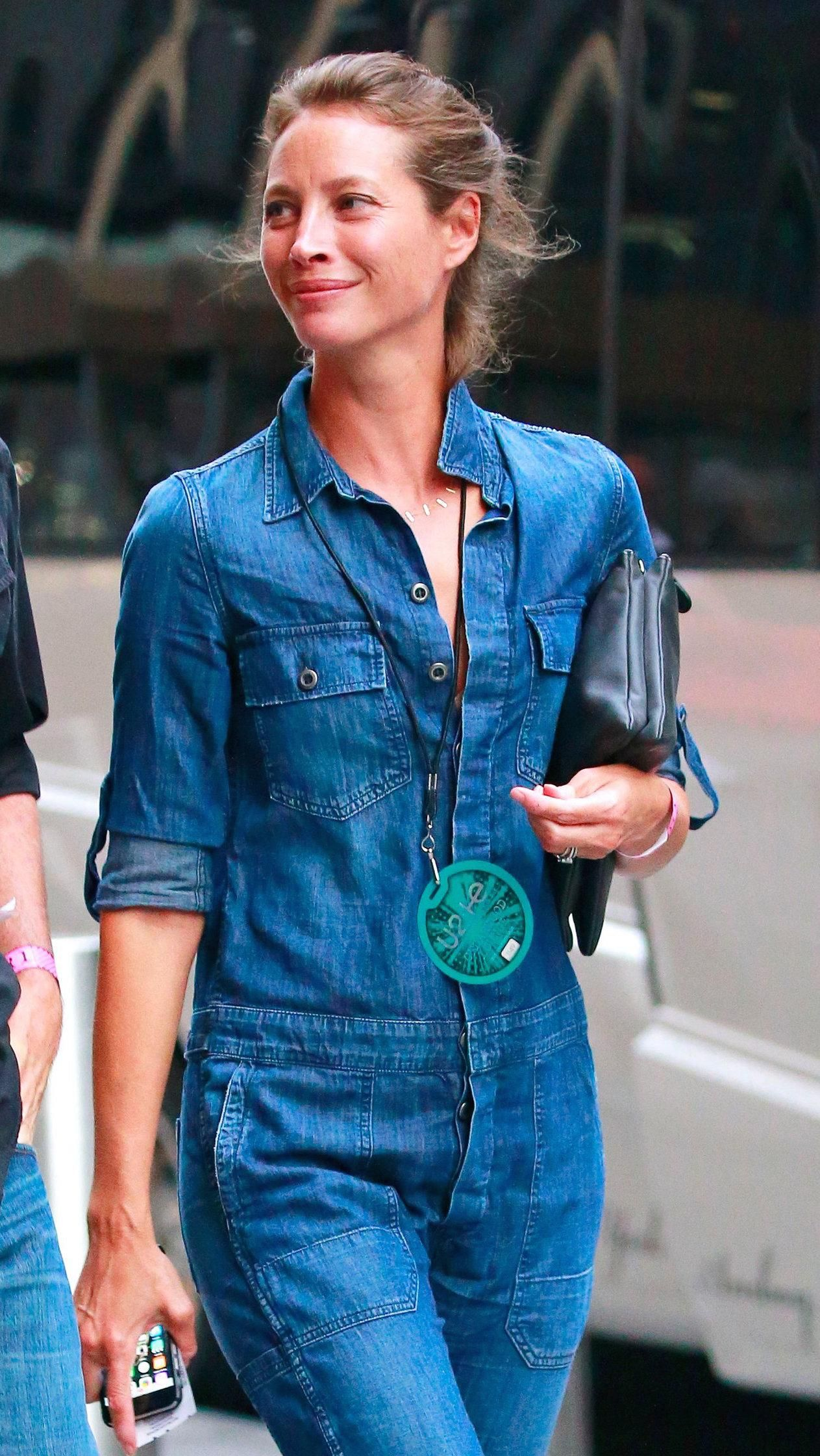 Christy Turlington Burns elevates overalls in Manhattan with a windswept bun and clean skin