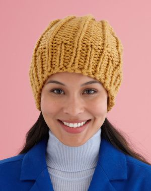 This Easy Rib Knit Hat from Lion Brand  Is knit up in a super bulky