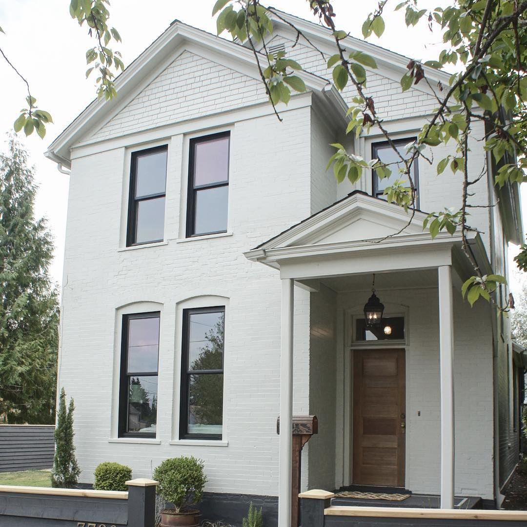 KAEMINGK DESIGN White brick Victorian farmhouse with