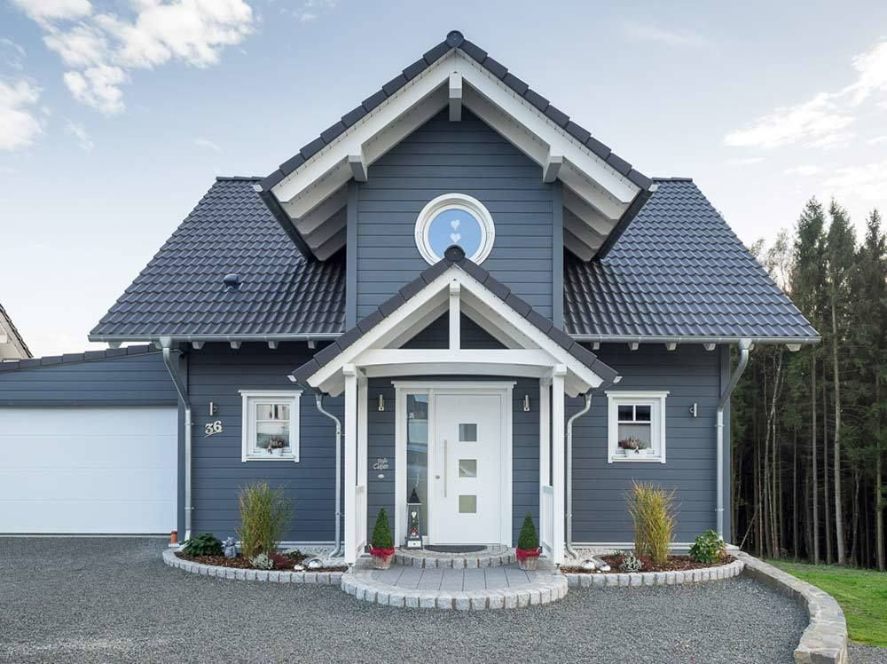 Photo of Scandinavian wooden house, entrance area with gable porch