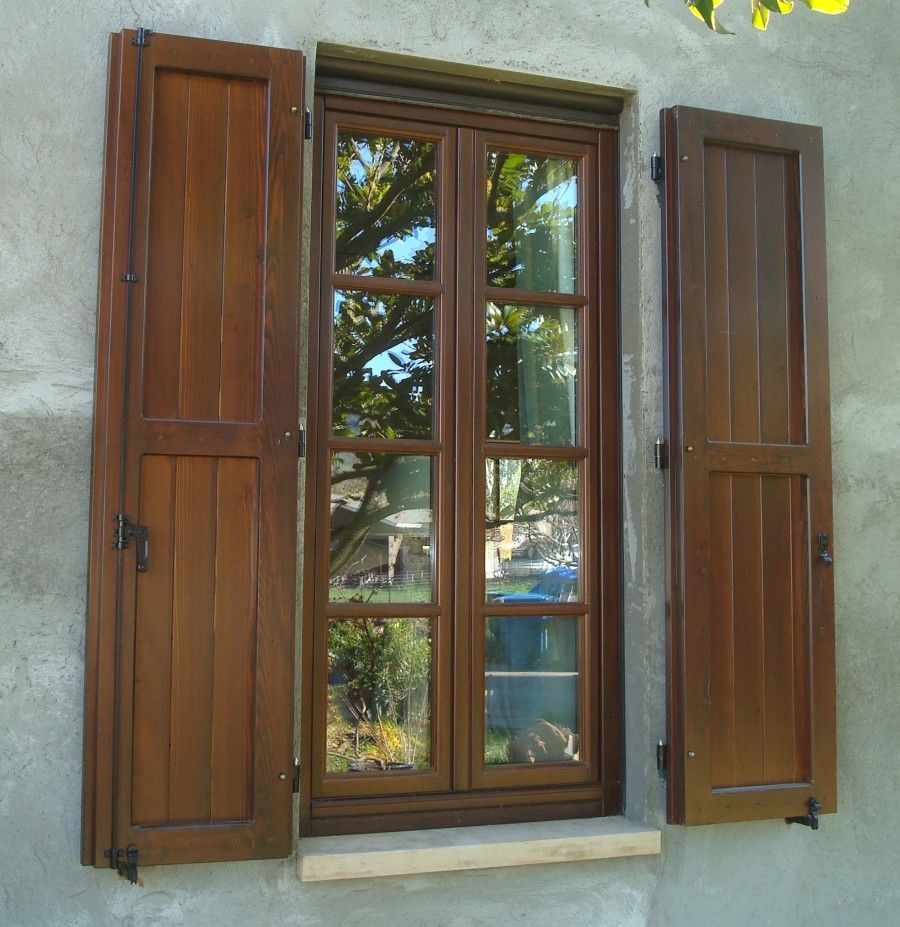 Enchanting teak exterior window shutters and old fashioned