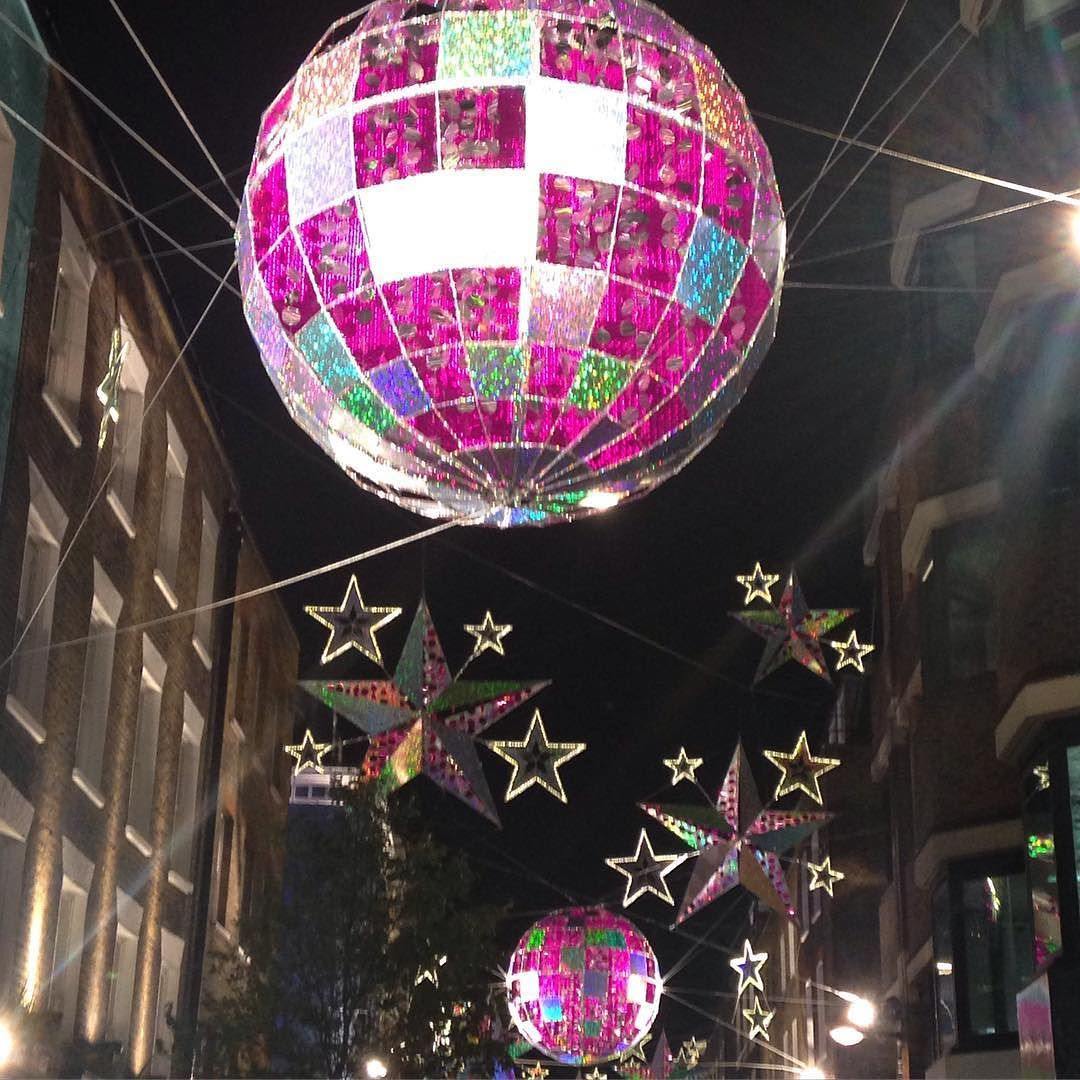 Carnaby St #christmaslights #wow #pink #christmas #christmastree #christmastheme #christmaswedding #christmasdecorations #weddingdecor #weddinginspiration #wedding #discoball #discolights #stars #carnabystreet #carnabychristmas #london #londonblog #londonblogger #weddingblog #weddingblogger #devinebride