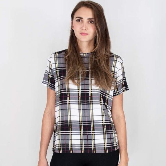 """The Fifth Tartan Print Plaid Jersey T-shirt Designer carried by Nasty Gal. The Building Blocks T-shirt is a casual tee with a bound neckline and a loose fit. The lightweight T-shirt is available in The Fifth's exclusive tartan print.  Main: 95% viscose / 5% elastane Exclusive Tartan Print Designed in Australia Measurements:   Small: Overall Length 25"""", Waist 36"""", Bust 36""""  Medium:  Overall Length 28"""", Waist 40"""", Bust 40"""" The Fifth Tops Tees - Short Sleeve"""