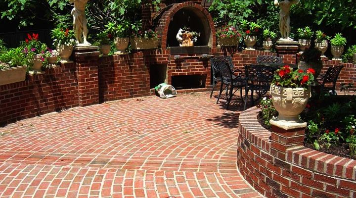 Brick Patio Wall Designs ground level paver patio with recessed fire pit and brick seating wall firepit Brick Walled Patio Patio Design That Leverages Brick This Is A Beautiful Patio Style