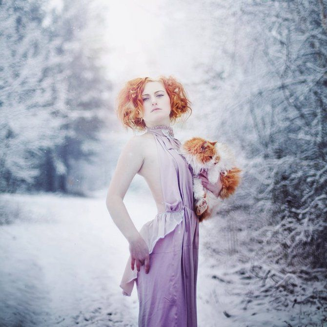 Wickedly awesome! Love the color in her hair & the cat. Such warmth in the cold environment.