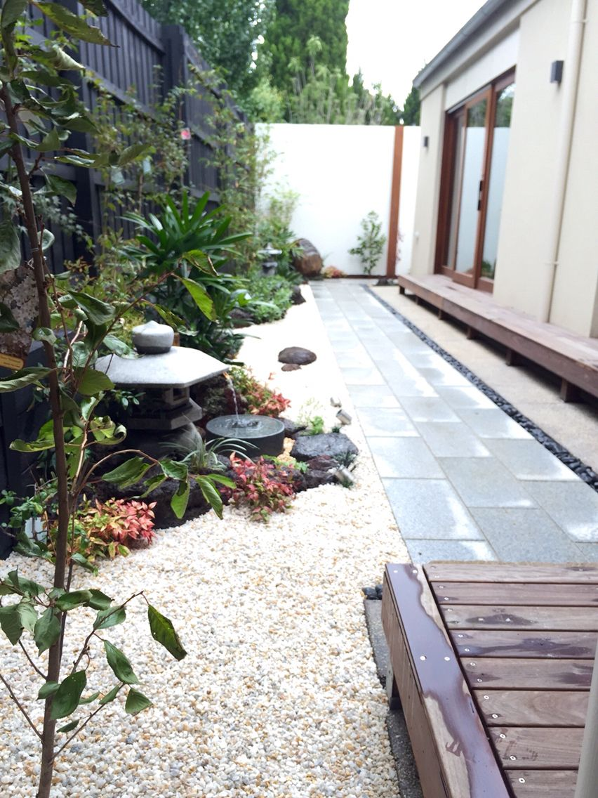 Looking down the length of the side garden with Japanese ...