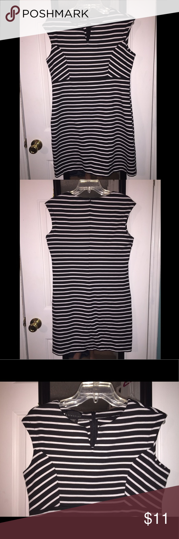 Attention Striped Dress Attention Striped Black & White Dress. Size medium. Has a tiny stain on the inside near the neck and it's missing the hook on the back, zips all the way up so you can't tell. Both of these flaws are pictured. Otherwise in very good condition Attention Dresses Midi