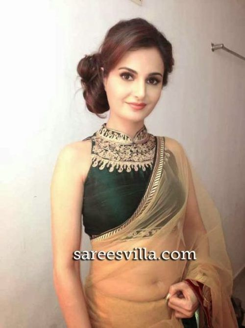 Loose Hair Bun Hairstyle For High Neck Nlouse Blouse Designs High Neck Saree Blouse High Neck Saree Blouse