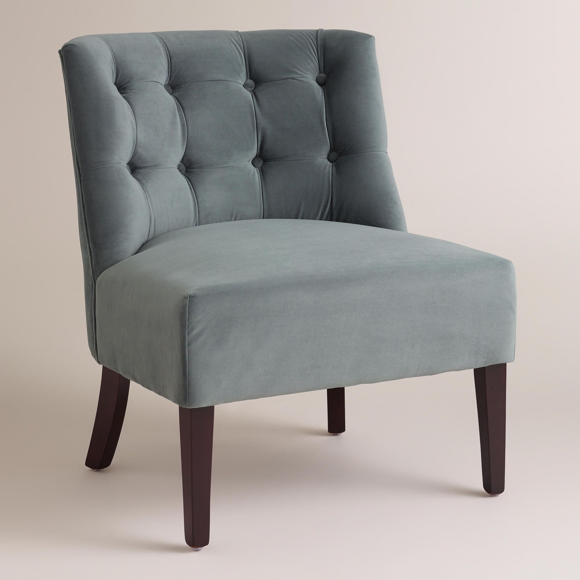 Chair in the corner of the family room with a floor lamp