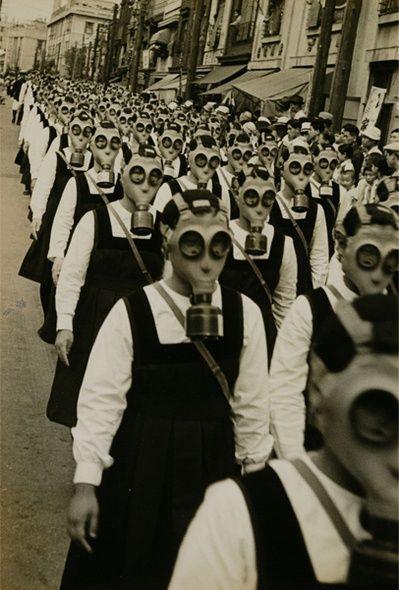 Schoolgirls wearing gas masks during WWII.
