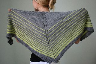 Shadow and Glow is a square shawl with endless wearability. This surprisingly versatile shape can be folded in half and worn as a cushy triangular shawl, wrapped around the neck as a scarf, or draped over the shoulders for a unique look. Graduated stripes in shadowy grey and glowing green play against each other in different ways depending on how the piece is worn. This is a very simple and relaxing knit, worked from the center out in Stockinette stitch with a Garter stitch border. Photos…