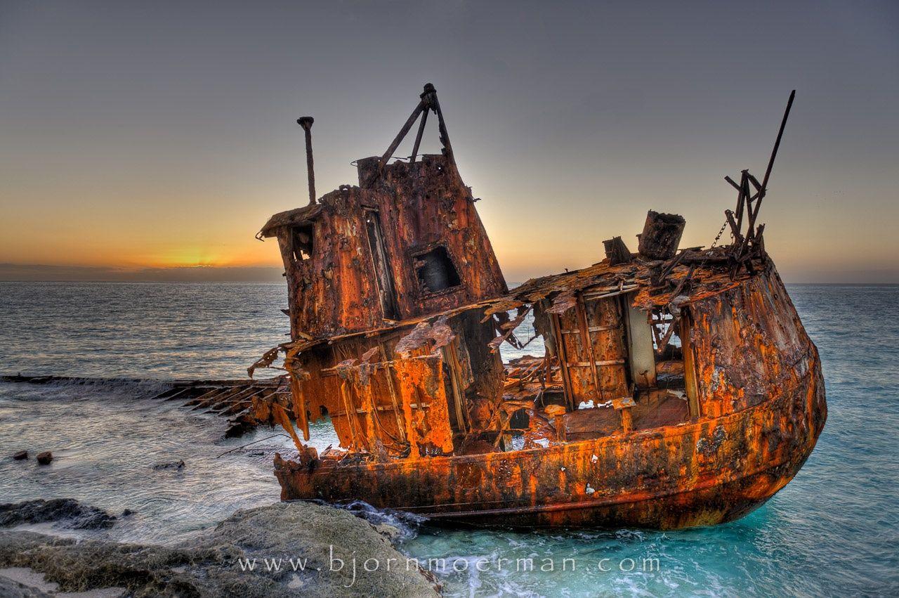 photograph old rusty ship at a bimini beach bahamas by bjorn