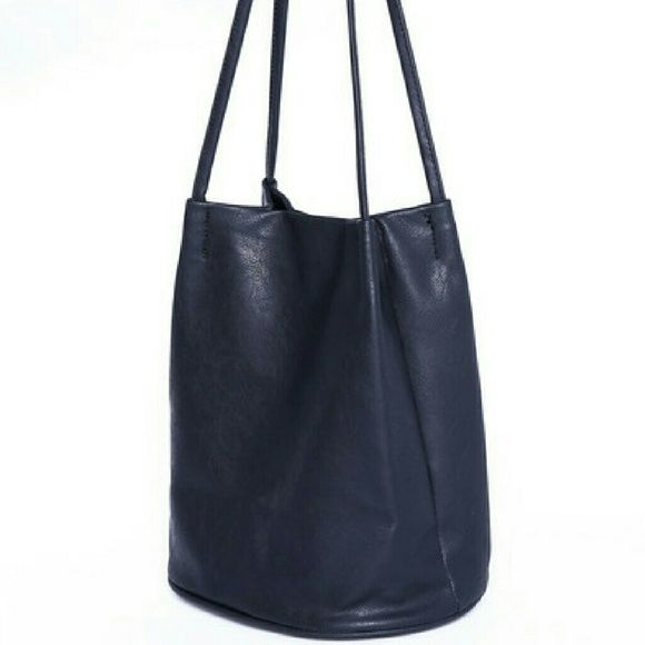Black bucket pu bag Its a cute,  small black bucket bag with a magnetic clasp and a zipper pouch inside. It didn't come with any tags, but it is new and unused. Bags Shoulder Bags