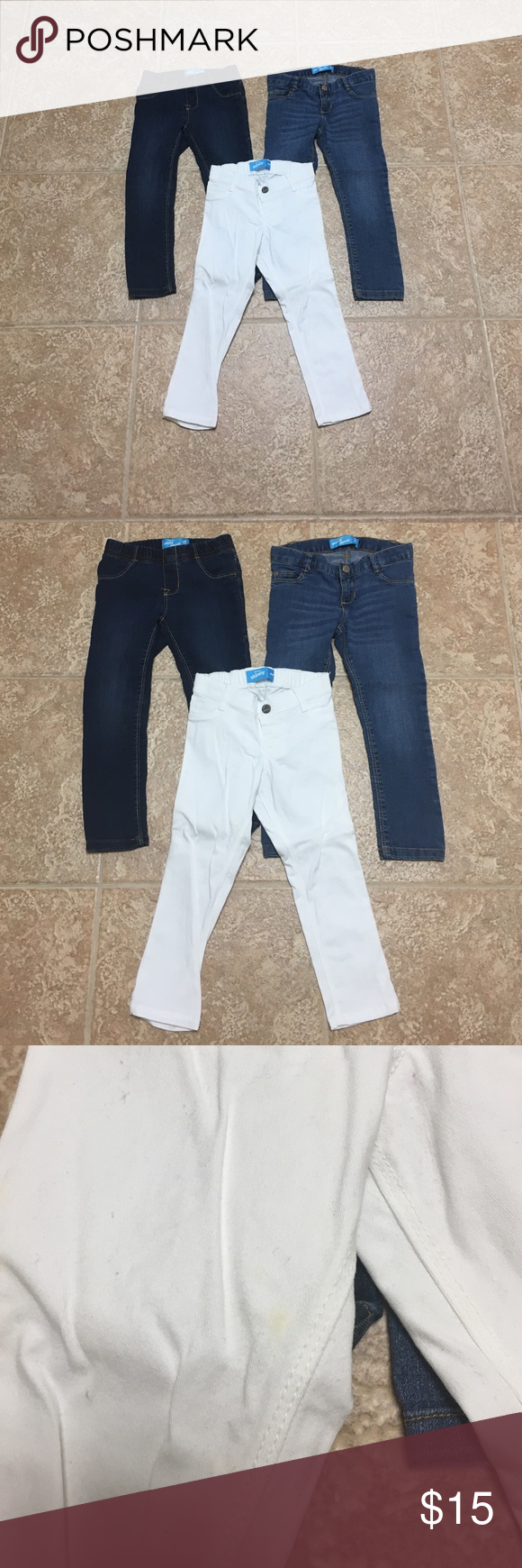 Toddler Jeans Bundle This listing includes 3 different wash jeans- dark wash, light wash, and white. The white jeans do have a small yellow stain in the front which is shown in the pictures but overall still in good condition the other two denim jeans are in perfect condition. Old Navy Bottoms Jeans