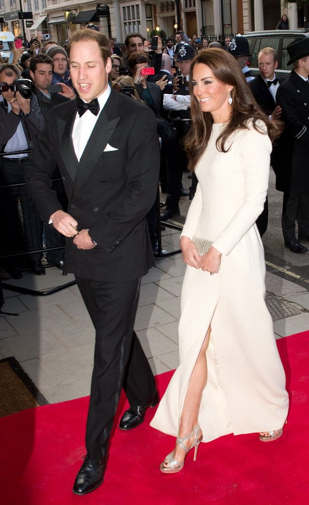 Kate Middleton Style: She turned heads in a white thigh-high slit Roland Mouret gown and silver Jimmy Choo heels.