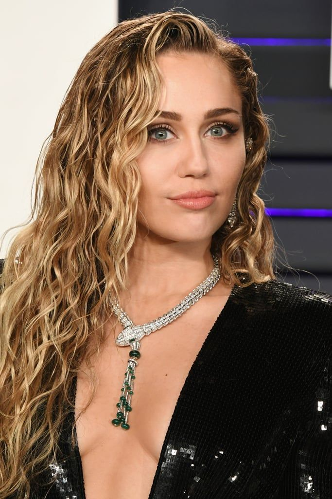 Photo of Miley Cyrus's Oscar Party Dress Dips So Low, She Might Need a Bigger Necklace