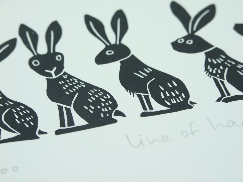 Line of Hares  handprinted lino cut by melaniewickham on Etsy, $25.00