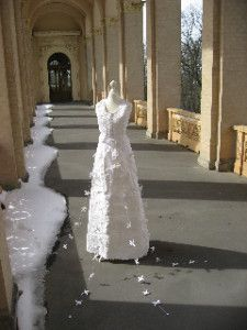 """Ausstellung """"hochZEITEN!"""" in Potsdam """"For the  """"one-time-use-dress"""" I have used paper /fabric. It was specially made for the dress with left overs cotton fabric and old lace I removed from old clothes of mine.  The paper pulp is also made of textile rags, rejects of production.  So this wedding dress is disposable and  100% re-used material."""" sagt Katell"""