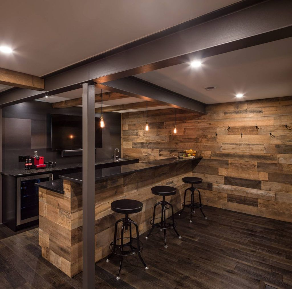 Rustic basement bar with steel beams and