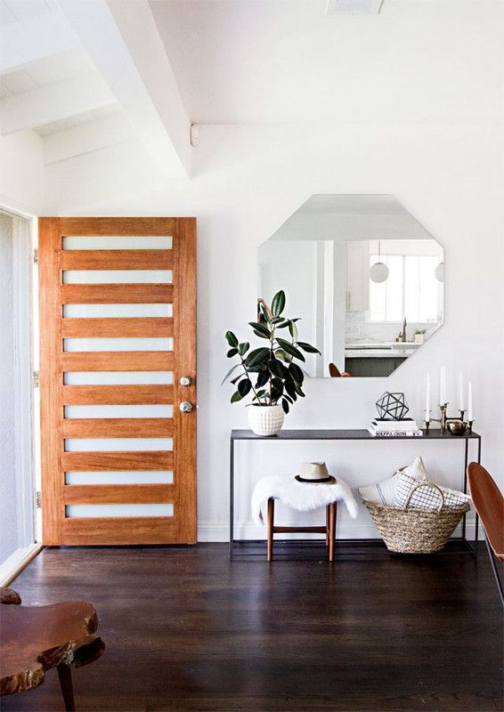 Warm Wood Door With Slats Console Table Hexagonal Mirror Basket Plant Stool