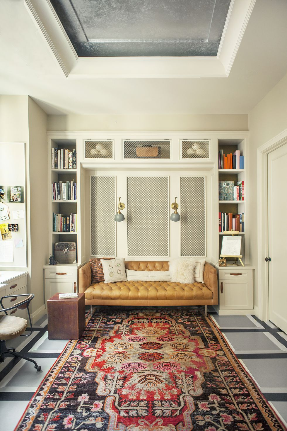 A spacious tribeca home office is cozied up with a rug find this pin and more on office decor ideas by elle