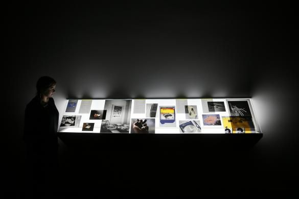 A woman looks at Source material from the artist's archive by Tris Vonna-Michell, at Tate Britain in London September 29, 2014. REUTERS-Stefan Wermuth