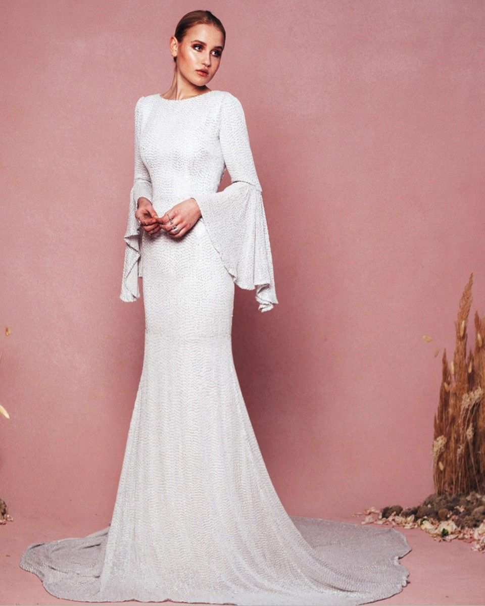 The Delfina Gown features a hand-beaded bodice, three-quarter bell ...