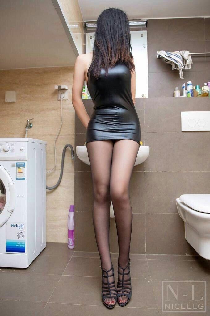 schwarzer Arsch im engen Kleid