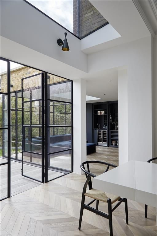 Photo of Strikingly modern glassy extension transforms listed house into a winning home