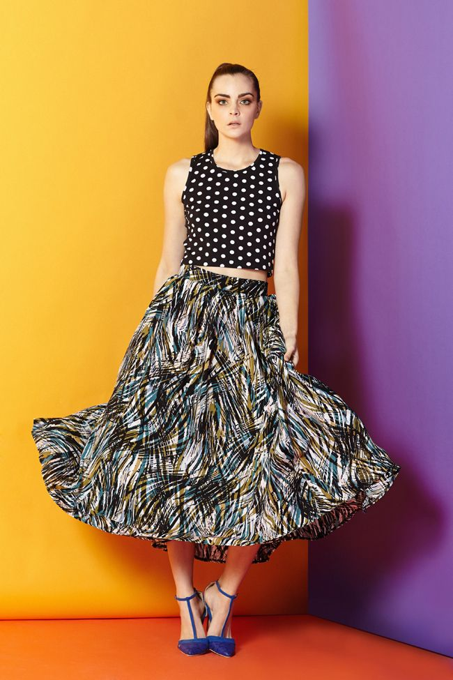 The Tropical Skirt  A skirt featuring tropical leaves and jungle hues can easily transition from the beach into the office – and beyond. All that needs to be added is a structured shirt and heels.