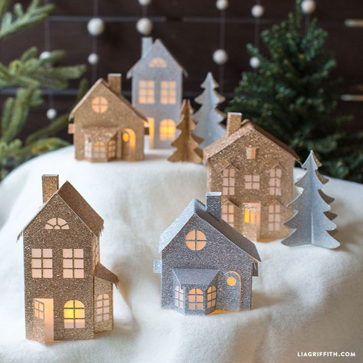 I love to have a 3D Holiday set that I can bring out and sit on my mantle or windowsill at this time of year. Our glitter paper winter village is the ideal DIY project for the Holiday season. It's super-fun to make if you have a cutting machine (just click on the SVG file...