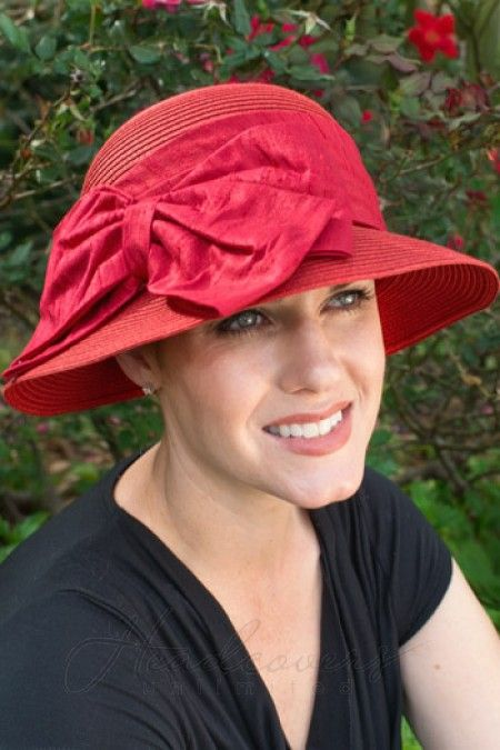 This fun hat features a large side bow b68559aa45d