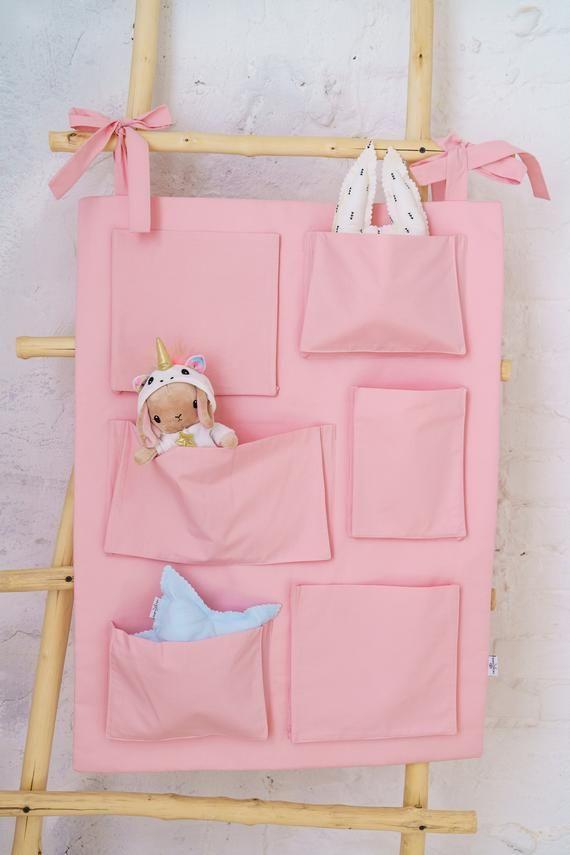 e1af0007c74d Pink nursery crib storage, wall hanging kids pocket organizer ...