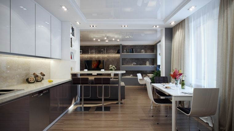 cucina a vista lineare con mobili grigi e bianchi laccati, tavolo e ...