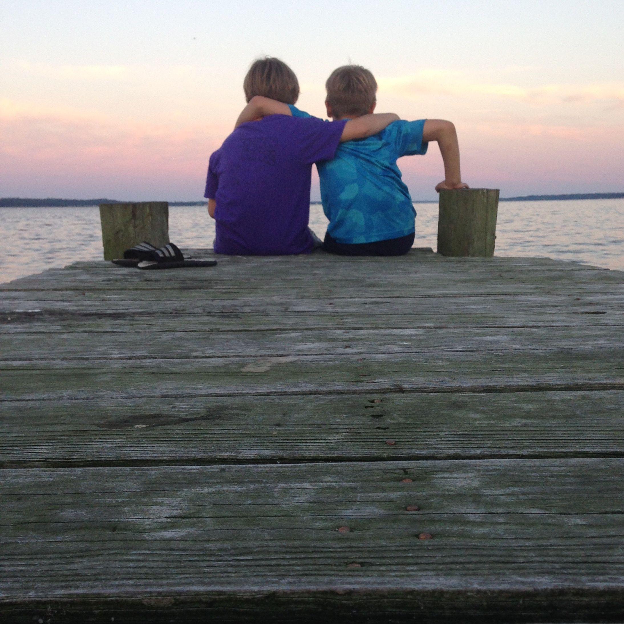 Brothers hug. Chesapeake Bay