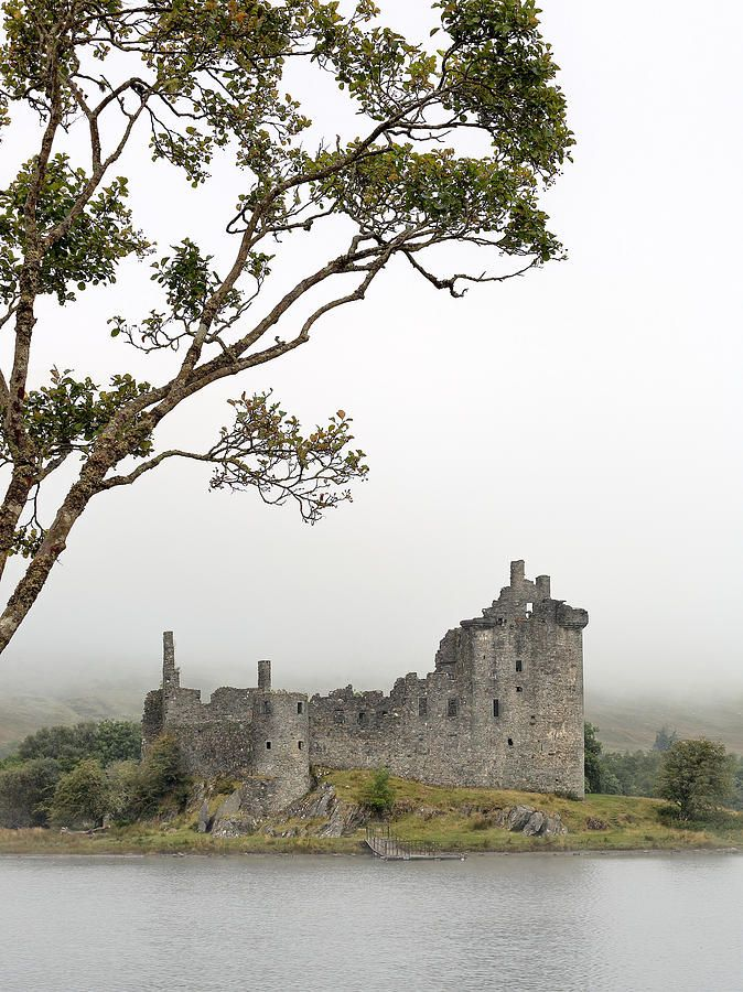 Kilchurn Castle from the shore of Loch Awe on a mist covered morning. Scotland