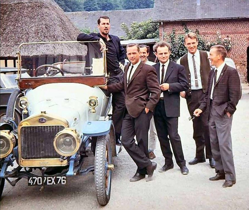 Dan Gurney & Friends. I only recognize four. In the old car, Jo ...