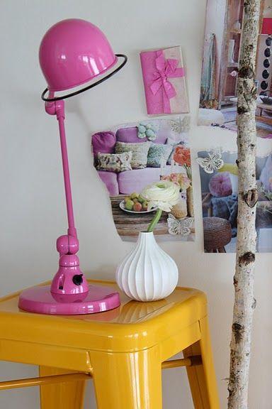 pink lamp yellow stool white walls
