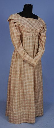 "Earlier in the 19th century plaid - silk plaid dress, c. 1820, cream & dusty pink damask with tapering long sleeves, high waistband, bodice decorated with applied sawtooth trim angled toward waist front and back with cord trim, bodice lined in muslin; bust: 30; waist (high) 23""; Length: 51""; 3/8"" hold in skirt front."