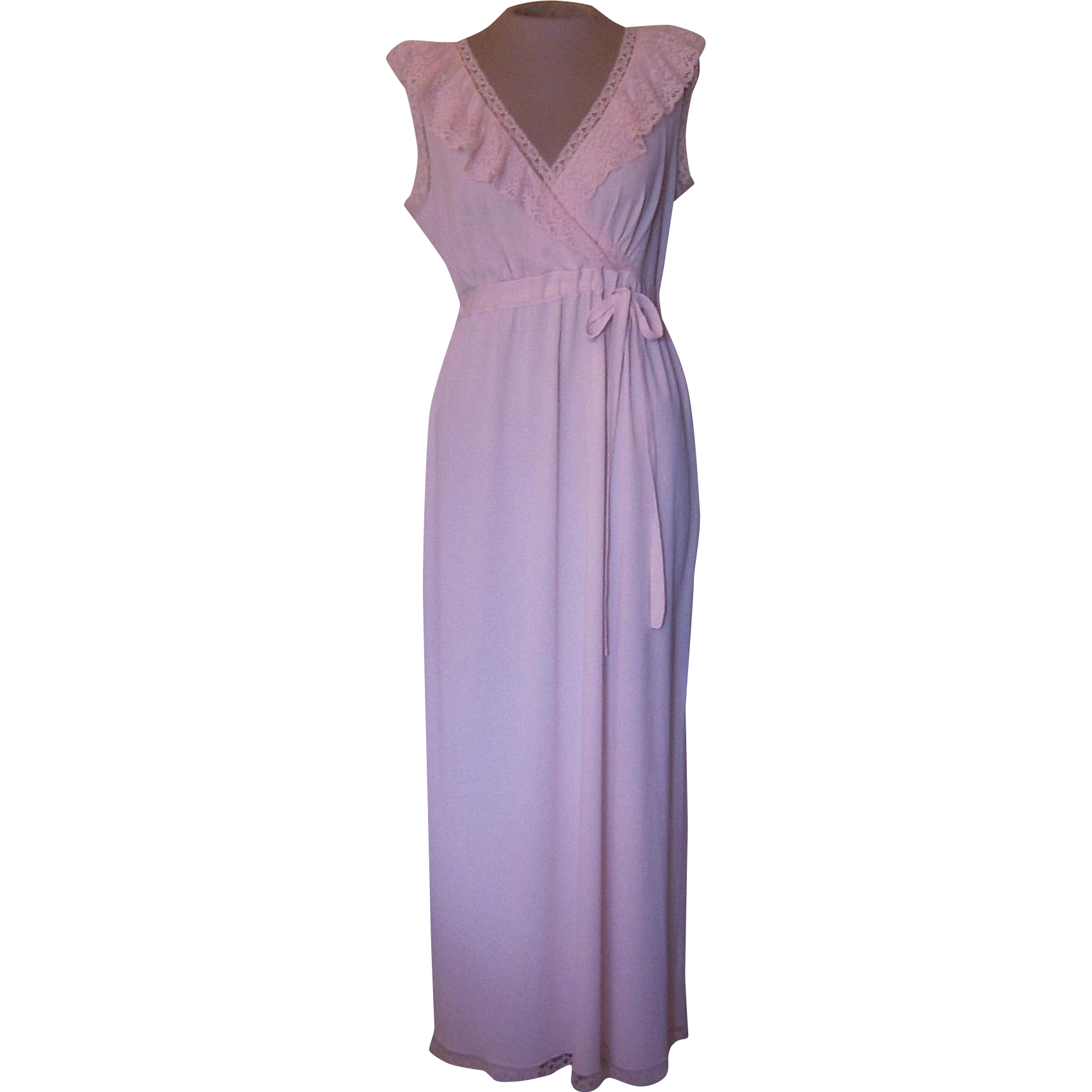 This is a lovely light pink long nightgown from France. The nightgown has a V in the front and there is a 1/2 inch wide pink lace that is along the V.