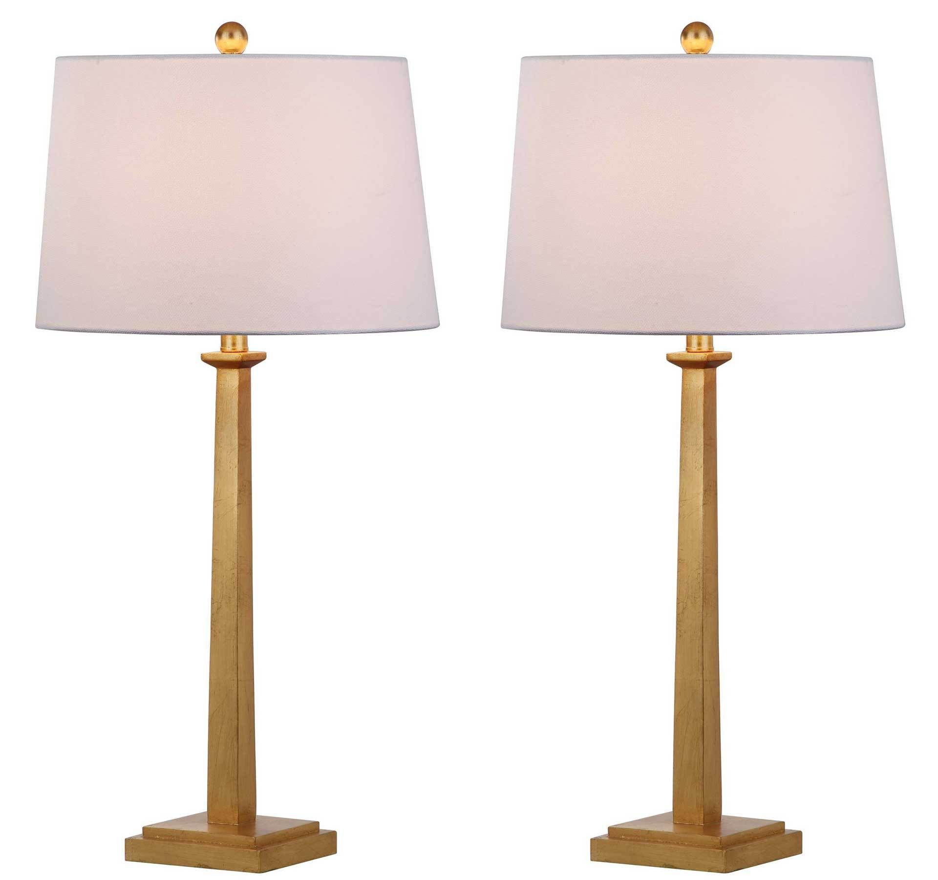 An iconic pre war apartment on new yorks upper east side inspired this modern table lamp finely crafted its gold finish illuminates any living room or