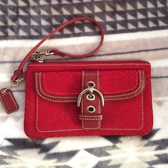 *Authentic* Coach Red wristlet Bought from Nordstorm years ago out of compulsion. Rarely used but has a few small stains on the back-Barely visible (2nd pic).Can use it for upcoming holiday events. Natural lighting in the 1st/4th pic. Price reflected on wear& as is. L-7.5in W-4 3/8in Coach Bags Clutches & Wristlets
