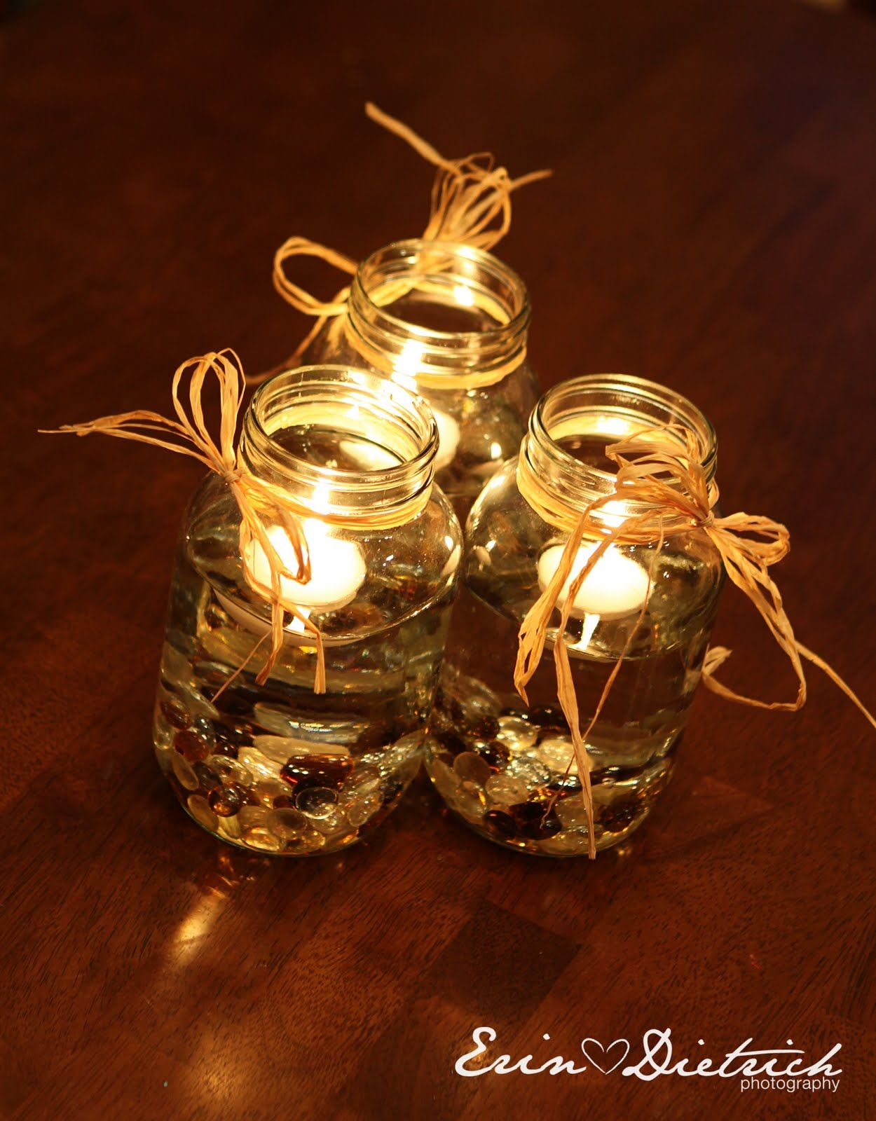 Floating candles u brown rocks event decorations pinterest